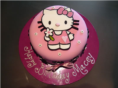 hello kitty cake with white flowers