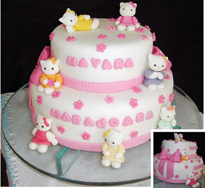 multiple hello kitties on a cake