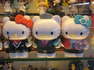 hello kitty figurines - hello kitty magician, hello kitty daniel, hello kitty businesswoman